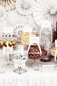 Chocolate table. Kit kat, malt balls, hershey kisses, chocolate covered pretzels, chocolate covered coffee beans. And a variety of chocolate types, too: White, dark, and milk!