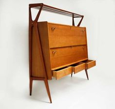 Bar cabinet by Louis Paolozzi for sale at Deconet