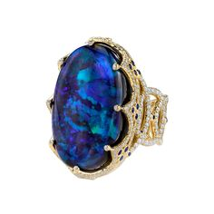 Erica Courtney® ROYAL RING 18K Yellow Gold ring featuring a 26.11 ct. Black Opal, .58 ctw. of Blue Sapphires, and 2.23 ctw. of Diamonds.