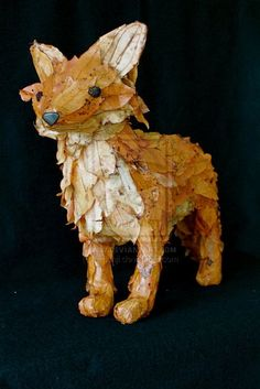 renard en papier mâché papier mache with leaves