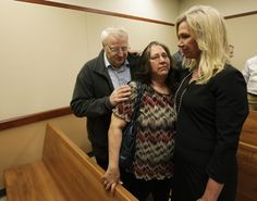April 24, 2012--Washington Post--photo of Anne Bremner with Chuck and Judy Cox as their relief upon hearing the evidence against Steve Powell stands and was legally obtained.