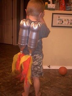 Jet Pack!  Spray painted 2-Liter bottles + tissue paper flames!