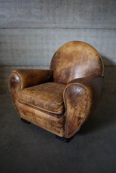Large Art Deco French Cognac Leather Club Chair, 1940s | From a unique collection of antique and modern club chairs at https://www.1stdibs.com/furniture/seating/club-chairs/