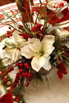 Christmas centerpiece - remember to keep them low in height so guest who face each other arn't blocked by it.