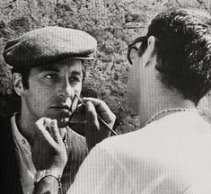 Al Pacino getting his makeup applied on the set of The Godfather (1972)