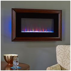"36"" Wall Mount Wood Frame Electric Fireplace at Big Lots....this is the coolest wall unit I've seen.  It changes colors :-)"
