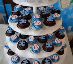"Another Cool idea...softball or baseball mom's did this for a fundraiser called ""Athletes Against Autism"", to raise money for Autism Speaks. We created a cupcake tower with half the cupcakes topped with baseballs and half with a puzzle piece which is the symbol used for autism."