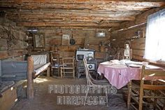 Buy or license direct from the photographer this stunning image of : Interior Shot Of A Typical American Pioneer Home With Bunk , Kitchen Table Set F . Small Log Cabin, Tiny House Cabin, Cabin Homes, Tiny Homes, Pioneer House, Pioneer Life, One Room Cabins, Log Cabin Kitchens, English Country Cottages