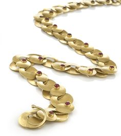 Same 18KY yellow gold Swirl Necklace with precious cabochon rubies.
