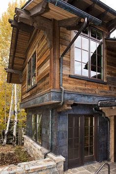 The reclaimed sunburnt siding on the exterior of this Rocky Mountain home contrasted with dark grey stone adds modernity to a luxury home with an otherwise rustic feel.  // Wood provided and installed by Arrigoni Woods.