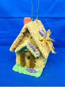 What bird would not want to have a spring fling in this pretty and edible bird seed covered birdhouse?