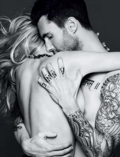 Adam Levine and the woman I like to pretend doesn't exist - his girlfriend.