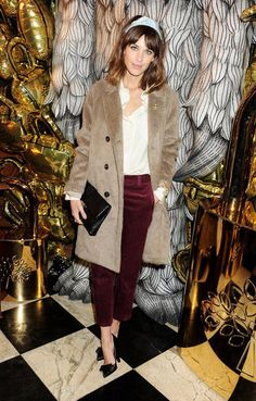 Alexa Chung finished a menswear vibe with a girlish pair of Louis Vuitton heels.