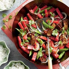 Beef-and-Watermelon Stir-Fry | The sweet heat of this dish is surprisingly refreshing. Garnish with fresh cilantro leaves for extra flavor. | #Recipes | SouthernLiving.com