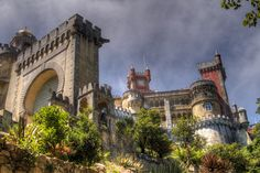 https://flic.kr/p/8hfd6d | Pena National Palace, Sintra, Portugal | The Pena National Palace is the oldest palace inspired by European Romanticism.  The construction occurred after an apparition of the Virgin Mary. In 1493, King John II, accompanied by his wife Queen Leonor, made a pilgrimage to the site to fulfill a vow.  For centuries Pena was a small, quiet place for meditation, housing a maximum of eighteen monks.  In the 18th century the monastery was severely damaged by lightning…