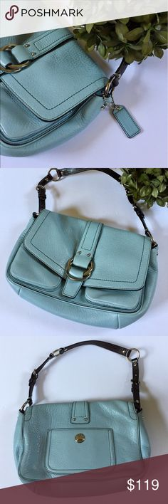 Coach robin's egg pebbled leather shoulder bag Authentic Coach light blue (color is best seen in first pic!) pebbled leather shoulder bag with hunter green interior. Dark brown strap. Multiple pockets including a zipper closure pocket and front and back pockets. Magnetic closure. Minimal signs of wear - scratches on silver hardware on back pocket as pictured, small ink mark on interior lining as well as barely noticeable ink mark on left front pocket. All shown in pictures. EUC otherwise…
