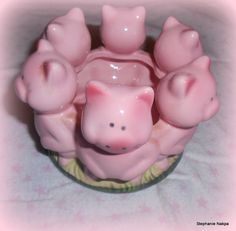 A pig candle holder.