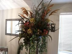 Large Home Decor Fl Featured On Wrought Iron Standing Base Arrangement Features Rustic Elegance Flowers Feathers Plums Dried Accents Greenery