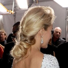 Carrie's hair was twisted into a super-extended spiral chignon that beautifully complemented her low-backed gown.