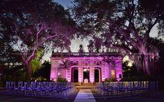 Wedding Ceremony with purple and fuchsia up lighting at Vizcaya