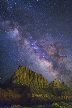 "Zion Galaxy--""The band of the Milky Way, our home galaxy of 100 billion stars, stands above the Zion National Park in southern Utah, USA. The Zion Canyon marks the junction of the Colorado Plateau and Mojave Desert regions."" by Wally Pacholka"