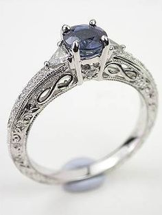Blue Sapphire Engagement Ring with Infinity Design but with a diamond Vintage Style Engagement Rings, Filigree Engagement Ring, Engagement Jewelry, Wedding Jewelry, Wedding Rings, Irish Engagement Rings, Pretty Rings, Beautiful Rings, Blue Sapphire Rings