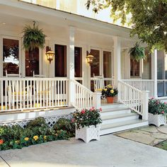 Classic White Porch - 80 Breezy Porches and Patios - Southernliving. Hanging ferns area a classic look for any Southern porch. Container gardens and a lush border add color to this space. Porches: Creating the Space Farmhouse Front Porches, Southern Porches, Southern Living, Southern Homes, Southern Cottage, Country Porches, Country Houses, Hanging Ferns, Hanging Baskets