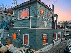 Yahoo Homes of the Week: Floating homes and houseboats for sale. I LOVE THIS-- the houseboat aspect and the color! Houseboat Living, Wood Boat Plans, Thing 1, Floating House, Tiny House Movement, Rustic Design, Great Rooms, Real Estate, House Styles