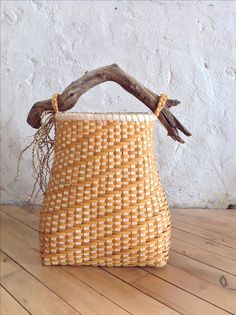Twill woven basket with driftwood handle by Laura Weber