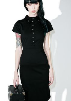 Disturbia Salem Pencil Dress fer all the wicked ones, like you bb. This witchy dress pencil dress features an empire waist with a super stretchy fit, dagger embroidered collar, and and a front, halfway button up detail with back zip closure.
