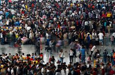 People wait for their trains during the first day of China's Mid-Autumn festival and National Day at Hongqiao train station, Shanghai, Oct. 1, 2012. (Carlos Barria/Reuters)#
