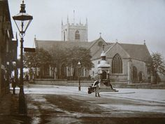 Hucknall Market Place and Green family memorial, wiith the Parish Church in the background.