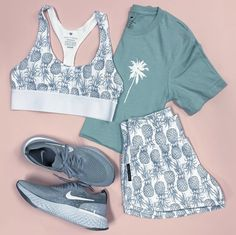 Summer Vibes in our Summer Collection. White Pineapple Sports bra & runners paired with our Palm Tree Logo Dusty Blue Crop