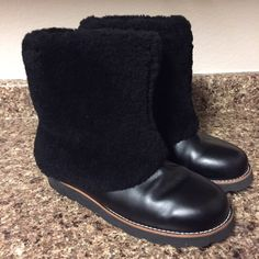UGG Australia Patten Leather Boots This pair is a store display without the original box. The sole is minimally work from store sampling. This is a size 11, but can also fit a size some size 12s since Ugg runs a little large. Ready for your closet! UGG Shoes Winter & Rain Boots