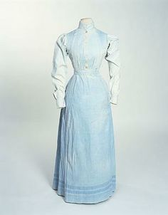 Servants dress, 1900. England. Blue cotton dress with high round neck and standing collar.