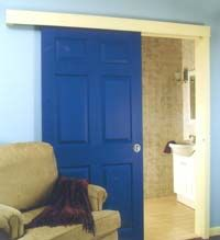 DIY Wall Mounted Door Tutorial - an alternative to pocket doors
