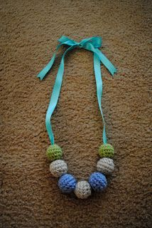 Nursing and teething necklace FREE crochet pattern! I'm going to need a few of these on hand I think, maybe I will make one to start... this would be an awesome baby gift I think.... btw it is noted from other sources that cotton yarn and unfinished wood beads are best because they contain the fewest chemicals making them safe for teething.