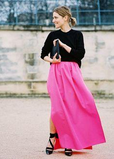 Rock a bold pink maxi skirt to dress up a plain tee
