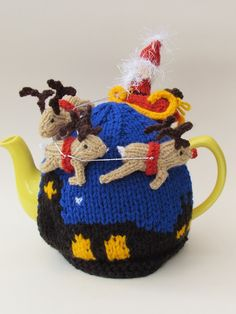 Knit yourself a Christmas Eve scene tea cosy. I love Santa's beard and bobble hat, he looks so cute!   Pattern and a readymade tea cosy available here http://www.teacosyfolk.co.uk/Santa's-Sleigh-Ride-Tea-cosy-p-113.php