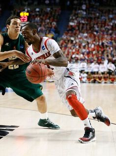 LEXINGTON, KY - MARCH 23: Russ Smith #2 of the Louisville Cardinals drives with the ball against Dorian Green #22 of the Colorado State Rams in the first half during the third round of the 2013 NCAA Mens Basketball Tournament at Rupp Arena on March 23, 2013 in Lexington, Kentucky.