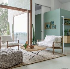 Living room trend green color wall of water, wood & white. Spring Collection – Summer by mirnafarhi Living Room Furniture, Home Furniture, Wall Of Water, Espace Design, Interior Styling, Interior Design, Living Room Trends, House Windows, Wall Colors