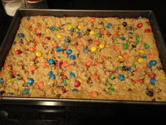 Monster Bars 1/2 c butter (I actually substitute apple sauce for this, and it works fine) 1 1/2 c peanut butter 1 c brown sugar 1 c white sugar 3 eggs (cream above ingred, then add): 1 tsp vanilla 1/2 tsp baking soda 4 1/2 c oatmeal (quick oats) 1 c m&m's 1 c chocolate chips Bake 15-16 min. @ 350