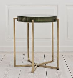 McCollin Bryan, 2000s, United Kingdom Tinted lens table with acrylic top and brass base.