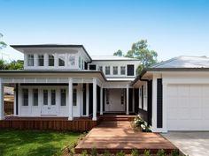 Stritt Design & Construction | Avalon Village Residence. Hamptons style exterior. Dark navy weatherboard. White timber windows and trim.