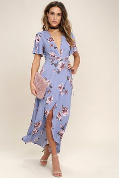 Bring your garden party dreams to life in the ASTR the Label Selma Periwinkle Floral Print Wrap Dress! Gauzy floral print fabric, in shades of pink, brown, and mauve, dance over slit, short sleeves, and wrapping bodice with modesty snap, and tying sash belt. High-low skirt ends at a maxi length.