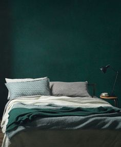 dark green wall and mixed linen. beautiful bedroom . Today I'm loving - French By Design: