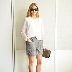 Day 4 Today I am wearing Italia Independent sunglasses, a Marni bag, Sretsis shorts, a Tibi top, and Jimmy Choo shoes