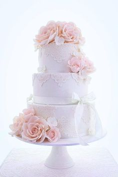 3 tiers of white lace adorned with my vintage style roses in the prettiest shade of pale pink.