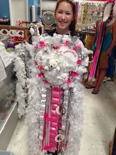 A happy Indianette from Keller High School so proud when she picked up her Senior Texas Heart Homecoming mum.  Spotlight Mums