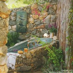 Neat idea for an outdoor tub.  I don't think I really want to bathe outdoors (living as close to my neighbors as I do), but I can see using an old tin tub as an outdoor water feature in the backyard.  This is at the Magnolia Pearl Ranch in Texas.